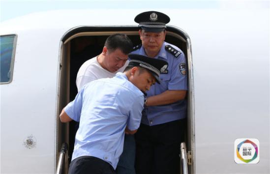 2019-05-23,杨进军被遣返回国。(新华社记者殷刚摄)