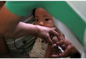 菲律宾多个地区暴发麻疹疫情 已致215人死亡